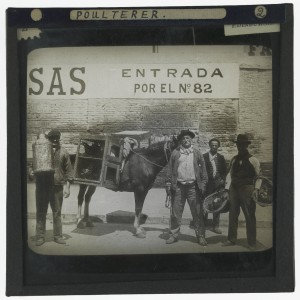 'Poulterer, Buenos Aires [Argentina]'. Photograph of a poulterer standing with his horse carrying cages of poultry on a street in Buenos Aires, Argentina in the early 20th century. Next to him is a man carrying a milk cannister, a man carrying two baskets of fruit and another man smoking a cigarette. http://images.is.ed.ac.uk/luna/servlet/s/19g4jx